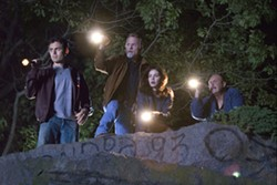 CLAIRE FOLGER / MIRAMAX - CURSING THE DARKNESS: Patrick (Casey Affleck), Bressant (Ed Harris), Angie (Michelle Monaghan) and Poole (John Ashton) shine light on a dire situation in Gone Baby Gone