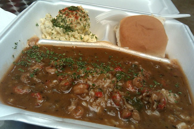 Daily special: Deliciously spicy Crawfish Etouffee, served with a bread roll and potato salad.