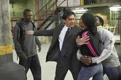 KERRY HAYES / NEW LINE - DANCE HALL DAZE Ballroom dance instructor Pierre Dulaine (Antonio Banderas) breaks up a skirmish between detention hall students Rock (Rob Brown) and Larette (Yaya DaCosta) in Take the Lead