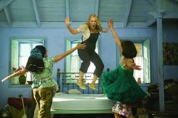 PETER MOUNTAIN / UNIVERSAL - DANCING QUEEN: Donna (Meryl Streep, with Julie Walters and Christine Baranski) adds some bounce to her life in Mamma Mia!