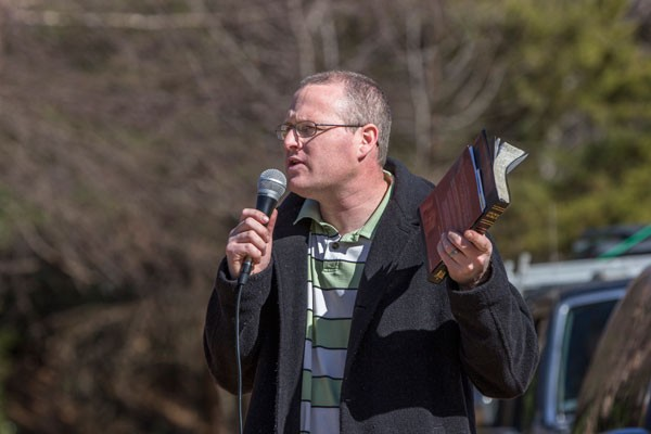 Daniel Parks preaches in front of A Preferred Women's Health Center - GRANT BALDWIN