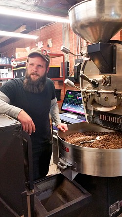 MELISSA OYLER - David Stein shows off Boquete Mountain's roasting process and equipment.