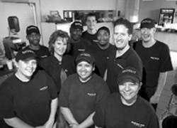 RADOK ATTA GRILL - Dawn and Mark C. White, owners and operators, - surrounded  by their staff.