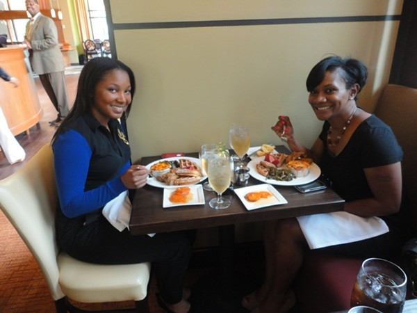 Ladies from the Urban enjoying Deltas' take on chicken and waffles