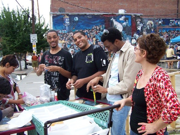 Diana Arvanites (right) with her Mobile Art Studio for Creative Disruption in NoDa, July 15, 2011