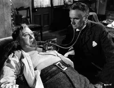 DOCTOR DOOM: Dr. MacFarlane (John Laurie) prepares to give Henry Hobson (Charles Laughton) the bad news in Hobson's Choice.