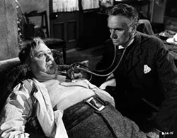 COURTESY OF THE CRITERION COLLECTION - DOCTOR DOOM: Dr. MacFarlane (John Laurie) prepares to give Henry Hobson (Charles Laughton) the bad news in Hobson's Choice.