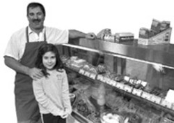 Domenico Puleio and his daughter, Mari Angela, at - Domenico's Italian Market