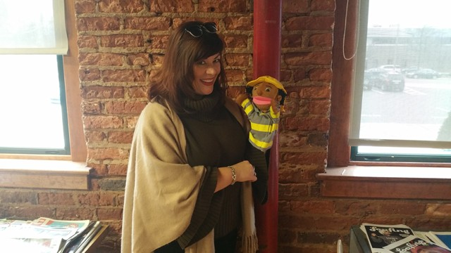 Donna Scott makes friends with our resident firefighter hand-puppet.