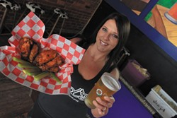 NATRICE BULLARD - Ed's Tavern server Ashleigh Douglas with the Chuck Norris wings