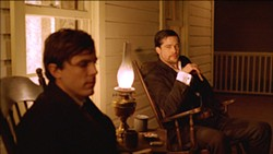 WARNER BROS. - ENLIGHTENED: Casey Affleck and Brad Pitt in The Assassination of Jesse James By the Coward Robert Ford