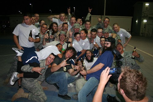 Evelynn Rose, Eric-Scott Guthrie and Tim Albright with troops at a base in the United Arab Emirates