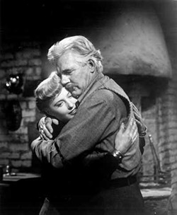 COURTESY OF THE CRITERION COLLECTION - FAMILY AFFAIR: Vance (Barbara Stanwyck) and T.C. Jeffords (Walter Huston) share a rare touchy-feely moment in The Furies.