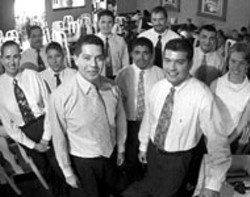 RADOK - Fernando and Alfredo Gomez surrounded by their staff - at Salsa's