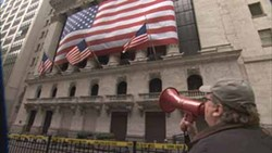 OVERTURE FILMS & FRONT STREET PRODUCTIONS - FLAGGING INAPPROPRIATE BEHAVIOR: Michael Moore declares the New York Stock Exchange a crime scene in Capitalism: A Love Story.