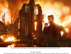 KERRY HAYES / FOX & MARVEL - FLAME ON Wolverine (Hugh Jackman) tries not to get hot under the collar in X-Men: The Last Stand