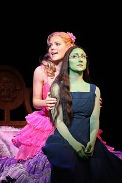 JOAN MARCUS - FLIGHTY: Dim witch Glinda (Katie Rose Clarke) tries to comfort misunderstood witch Elphaba (Carmen Cusack) in Wicked