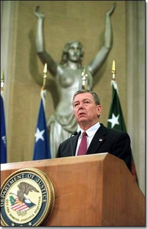 Former U.S. Atty Gen John Ashcroft standing before horrifying, pre-drapes statue of Justice-with-Breasts