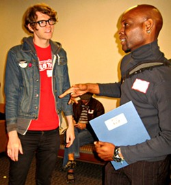 From left, Dante Strobino of UE Local 150, North Carolina Public Service Workers Union, and James Lee Walker II of Occupy Charlotte participated in Saturday's discussions.