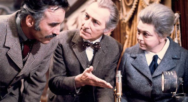 FULLY TRAINED: Professor Saxton (Christopher Lee), Dr. Wells (Peter Cushing) and Miss Jones (Alice Reinhart) examine the evidence aboard the Horror Express. (Photo: Severin)