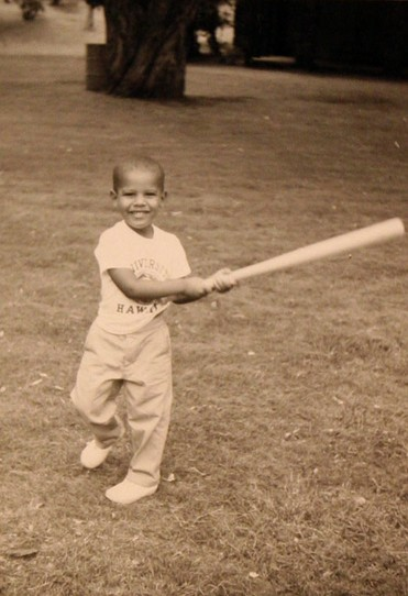 Future President practicing his homerun swing