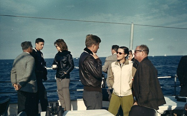 George Plimpton (second from left) hanging out with Jackie Kennedy (third from left) and JFK (center).