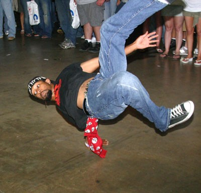 "GIVE HIM A BREAK: Looks like this unnamed dancer, who showed his skills last Saturday in the Charlotte Merchandise Mart at the Boost Mobile Hot Import Nights car show, is about to put a literal spin on the art form known as break dancing. Get it -- ""break"" dancing? Funny, eh? - JASIATIC"