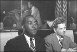 "GOLDEN AGE OF JAZZ  Bird with his ardent disciple, - trumpeter Robert ""Red"" Rodney;  in the mirror: Dizzy - Gillespie  and Clyde Lombardi"