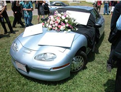 MATT BOHLING / SONY PICTURES CLASSIC - GRAVE SITUATION A mock funeral is held for the EV1 in Who Killed the Electric Car?
