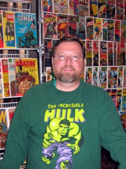 TIMOTHY C. DAVIS - Green with envy: The not-overly-excitable Banks - Robinson of Columbia's Comic Whiz with his comics - collection