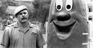 GRIN AND BEAR IT: Former Chicago Bears linebacker Dick Butkus and the Busterburger torture pickle in Hamburger: The Motion Picture. (Photo: Busterburger Limited Partnership)