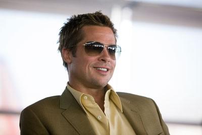 GRIN AND BEAR IT: Rusty Ryan (Brad Pitt) enjoys the con in Ocean's Thirteen ...