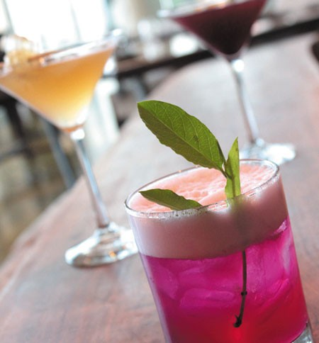 Halcyon signature cocktails include the Pink Heelsplitter (front); Queen 2 Bee (back left); and Pickled Up in Blue (back right) - NATRICE BULLARD