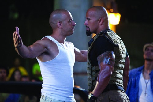 HEATED EXCHANGE: Matching chrome domes Dominic Toretto (Vin Diesel) and Luke Hobbs (Dwayne Johnson) mix it up in Fast Five. (Photo: Universal)