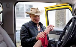 GLEN WILSON / COLUMBIA PICTURES - HELPING HAND: Tallahassee (Woody Harrelson) discovers the remnants of a zombie attack in Zombieland.