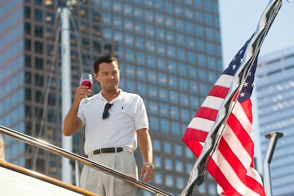 HERE'S TO THE AMERICAN DREAM: Jordan Belfort (Leonardo DiCaprio) salutes his own success in The Wolf of Wall Street. (Photo: Paramount)