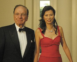 HIS AND HERSPACE: Do we need more reasons to hate Rupert Murdoch, beyond his wealth, media dominance and control of MySpace? How about envying him for his trophy wife, Wendi Deng, shown here with him at a May White House reception. - NEWSCOM-CARRIE DEVORAH/WENN