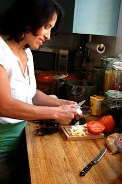 JASIATIC - HOME COOKIN': Teresa Hernandez prepares red mole