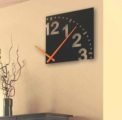 Home Eclectic - The Infinity wall clock, 12 in diameter, black background with orange hands, makes a great conversation piece. Retail $39.99 - 601 S. Kings Drive. 704-332-4346 - Open 7 days a week - www.home-eclectic.com - Credit cards accepted