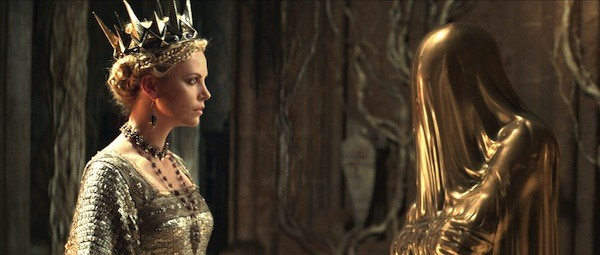 I'M STARTING WITH THE MAN IN THE MIRROR: The Queen (Charlize Theron) asks the Mirror Man fair questions in Snow White and the Huntsman. (Universal Pictures).