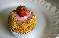 Pistachio cupcakes with strawberry buttercream
