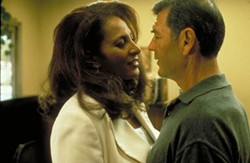 LIONSGATE & MIRAMAX - IN IT TOGETHER: Jackie Brown (Pam Grier) and Max Cherry (Robert Forster) hatch a plot in Jackie Brown.