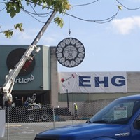 """In September, crews hauled away the old mall's """"Rising Sun"""" signs for preservation."""