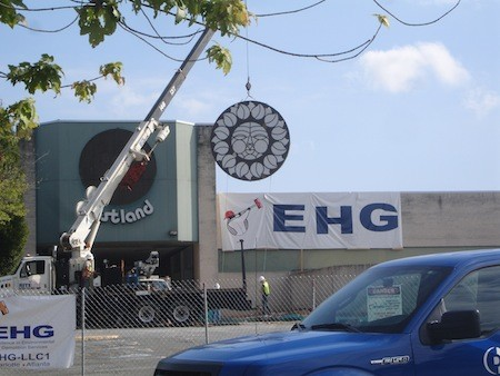 In September, crews hauled away the old malls Rising Sun signs for preservation.