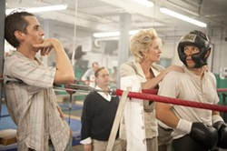 PARAMOUNT - IN THE CLEARING STANDS A BOXER: Christian Bale, Melissa Leo and Mark Wahlberg in The Fighter