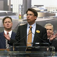 IT'S PAT: Former Mayor Pat McCrory (center) with NASCAR Chairman and CEO Brian France (left) and former Gov. Mike Easley in March 2006
