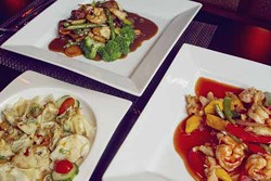 ASHLEY GOODWIN - IT'S THE WILD, WILD EAST: An array of dishes at Wild East Pan-Asian Bistro