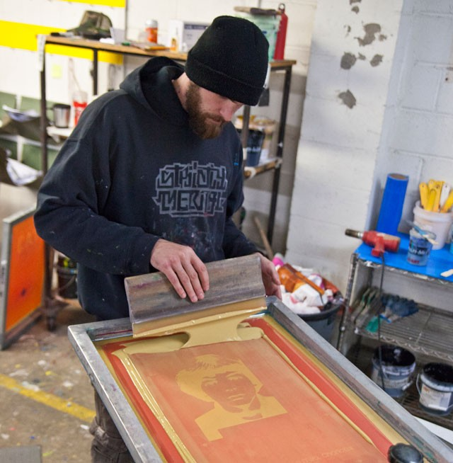 Jacob Freve screen prints a Reclaimed promotional poster.