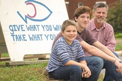 NATRICE BULLARD - J.D. Lewis (far right) and his sons Buck (far left) and Jackson volunteered around the world.