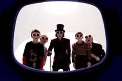 WARNER BROS. - Johnny Depp and posse in Charlie and the Chocolate Factory